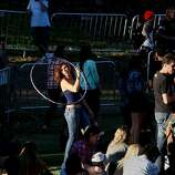 Bryn Panzera dances with a hoop at the Hardly Strictly Bluegrass Festival in Golden Gate Park, in San Francisco, Ca, on Friday Oct. 4, 2013
