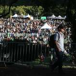 Chris Michel of San Francisco walks along a dirt road above the Arrow Stage at the Hardly Strictly Bluegrass Festival in Golden Gate Park, in San Francisco, Ca, on Friday Oct. 4, 2013