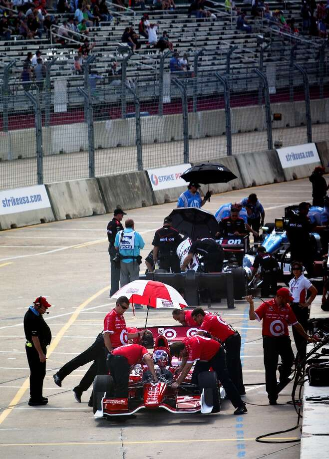 The pit crew preps Target car driver Scott Dixon before practice at the Grand Prix Houston, Friday, Oct. 4, 2013, in Houston. (Cody Duty / Houston Chronicle) Photo: Houston Chronicle