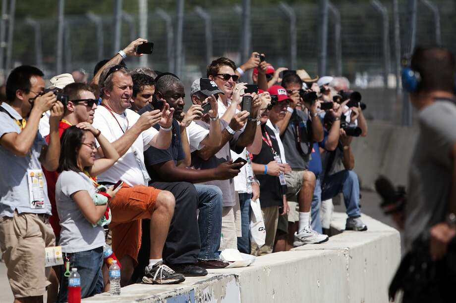 Spectators watch as Indy cars take off for practice during the Grand Prix Houston, Friday, Oct. 4, 2013, in Houston. (Cody Duty / Houston Chronicle) Photo: Houston Chronicle