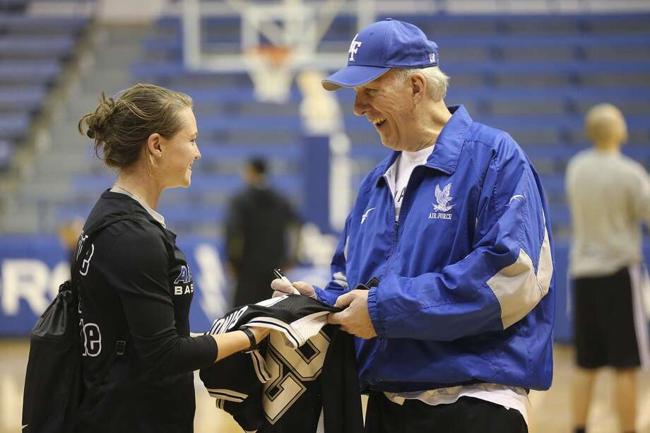 San Antonio Spurs Head Coach Gregg Popovich signs an autograph for U.S. Air Force Women's Basketball guard Izzie Englehart, 18, after a light team workout on their last day at the United State Air Force Academy in Colorado Springs, Colorado, Friday, Oct. 4, 2013. The Spurs spent the week training at the academy and will play a scrimmage at the AT&T Center on Sunday. It will be open to the public. Photo: San Antonio Express-News