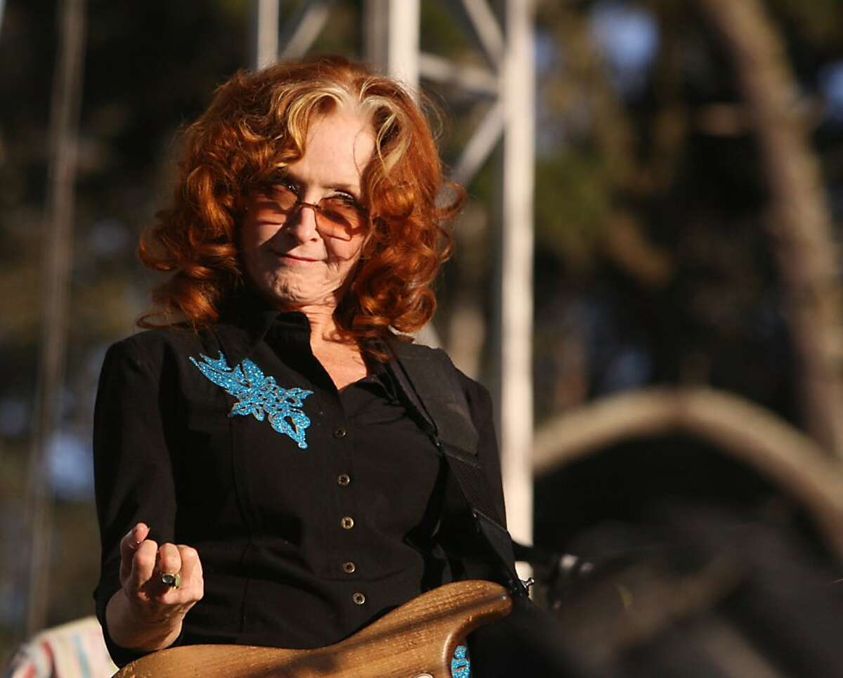 Bonnie Raitt gestures at the crowd during her performance at the Hardly Strictly Bluegrass Festival in Golden Gate Park, in San Francisco, Ca, on Friday Oct. 4, 2013
