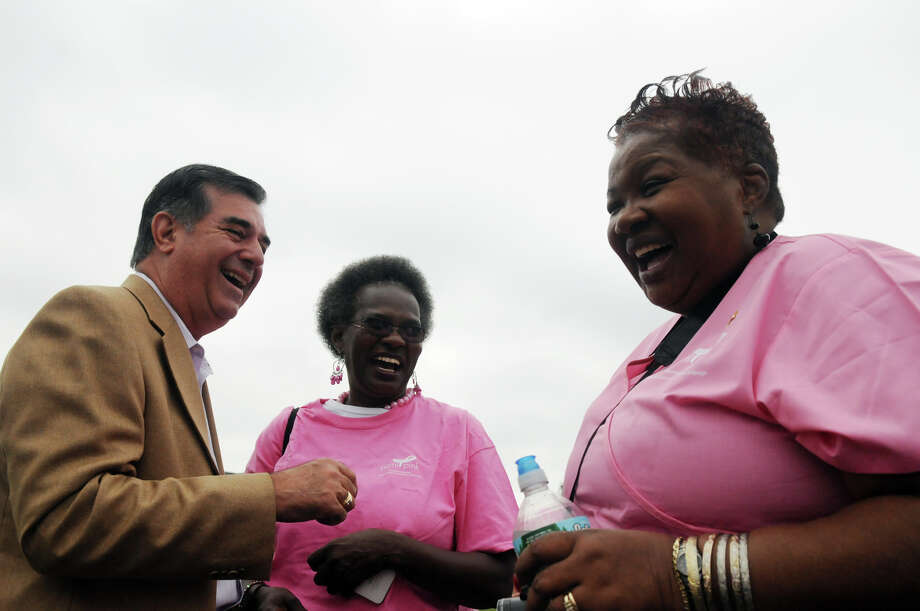 "Mayor Michael Pavia shares a laugh with Doreen Harrison and Cynthia Bates as they join breast cancer survivors and supporters to kick off Stamford Hospital's annual ""Paint the Town Pink"" campaign by donning pink and lining the sidewalk along Mill River Park in Stamford, Conn., October 5, 2013. The campaign, in its ninth year, is aimed at raising awareness and stressing the importance of early detection. Photo: Keelin Daly / Stamford Advocate Freelance"