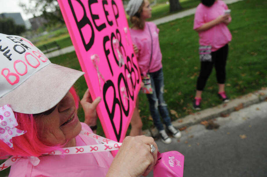 "Karen Sabia came complete with a pink cow bell as she joins breast cancer survivors and supporters to kick off Stamford Hospital's annual ""Paint the Town Pink"" campaign by donning pink and lining the sidewalk along Mill River Park in Stamford, Conn., October 5, 2013. The campaign, in its ninth year, is aimed at raising awareness and stressing the importance of early detection. Photo: Keelin Daly / Stamford Advocate Freelance"