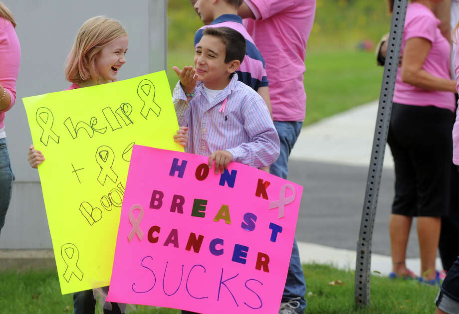 "Ashton Ferrajina, 7, and Cadence Jagodzinski, 8, join breast cancer survivors and supporters to kick off Stamford Hospital's annual ""Paint the Town Pink"" campaign by donning pink and lining the sidewalk along Mill River Park in Stamford, Conn., October 5, 2013. The campaign, in its ninth year, is aimed at raising awareness and stressing the importance of early detection. Photo: Keelin Daly / Stamford Advocate Freelance"