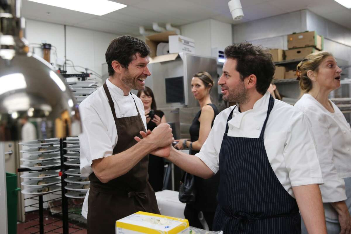 Daniel Patterson of Coi greets Matthew Accarrino of SPQR in the kitchen during the James Beard Foundation's Taste America benefit dinner at the St. Regis.