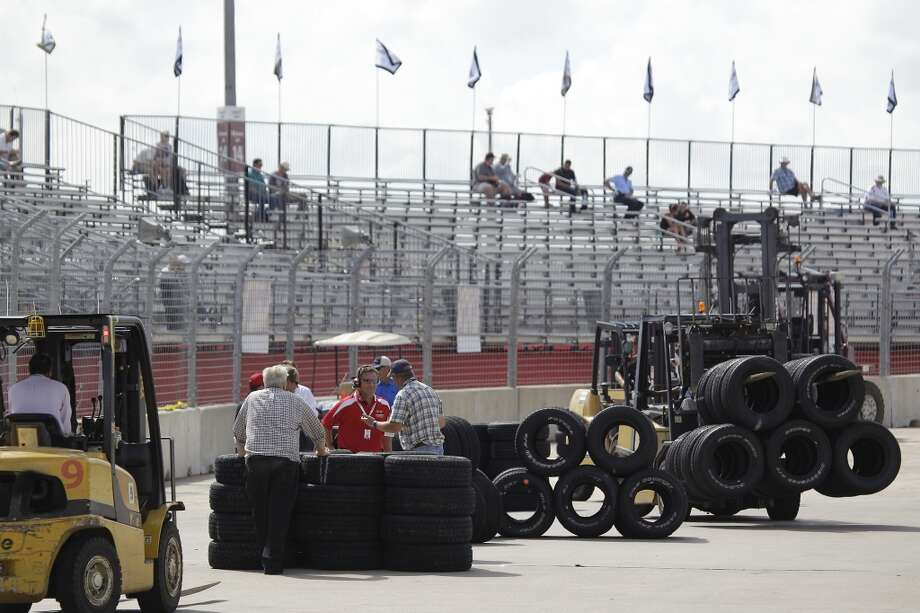 Officials install a temporary chicane at turn one  to help drivers avoid a problem with the surface of the track of the Grand Prix of Houston course at Reliant Park Friday, Oct. 4, 2013, in Houston.  IndyCar qualifying was reschedule for Saturday. Officials plan to make repairs to track overnight. ( Melissa Phillip / Houston Chronicle ) Photo: Melissa Phillip, Houston Chronicle