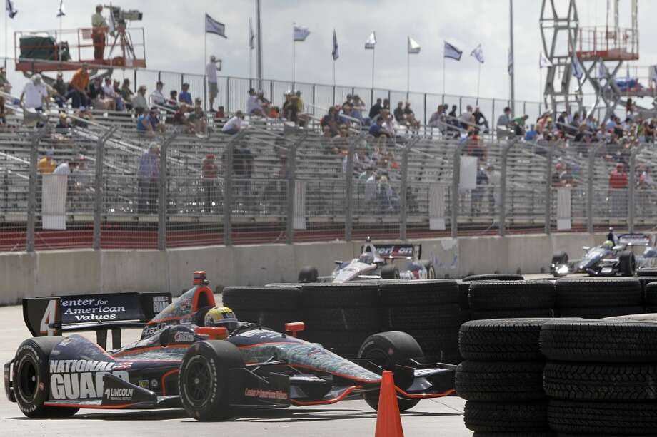 IndyCar driver, Oriol Servia, maneuvers around a temporary chicane installed at turn one during practice at Grand Prix of Houston course at Reliant Park Friday, Oct. 4, 2013, in Houston. Race practice was delayed while officials installed a temporary chicane to help driver avoid a problem with the surface of the track. IndyCar qualifying was reschedule for Saturday. Officials plan to make repairs to track overnight. ( Melissa Phillip / Houston Chronicle ) Photo: Melissa Phillip, Houston Chronicle
