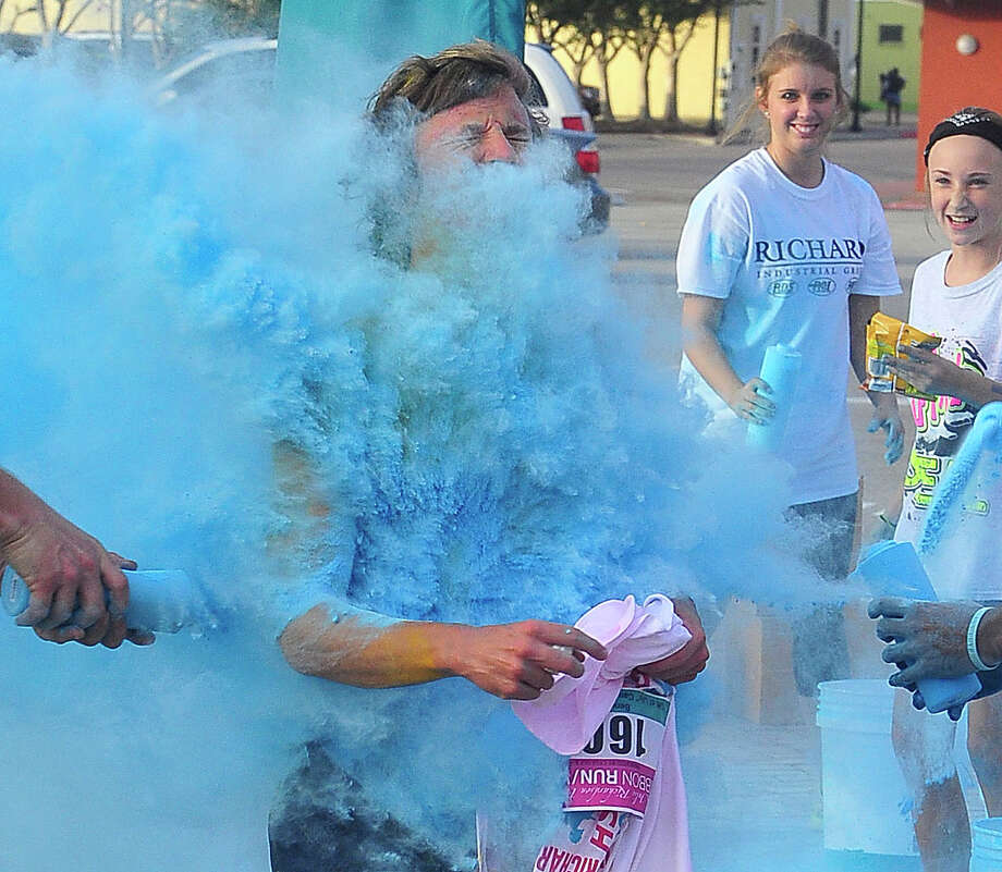 People of all ages gathered in downtown Beaumont on Saturday morning eager to participate in the 2013 Gift of Life 5K Ribbon Run Color Rush, where participants were covered in different colors along the race. Photo: Cassie Smith