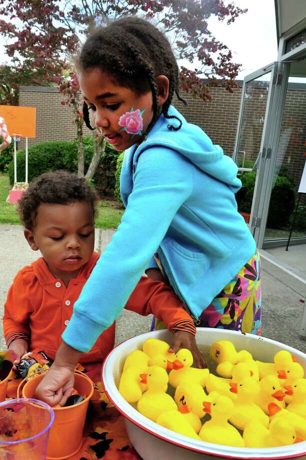 Andrew Robinson, 2, and his sister, Lauryn, 6, play with the duck pond, during the United Methodist Church's Pumpkin Festival in Danbury, Conn. Saturday, Oct. 5, 2013. Photo: Michael Duffy / The News-Times