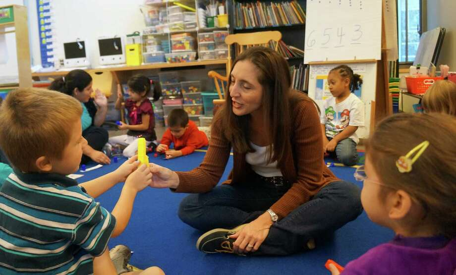 Hamilton Avenue School kindergarten teacher Lisa Cutler compares the number of pieces in her tower to her student's during a counting and cardinality exercise. Photo: Greenwich Time