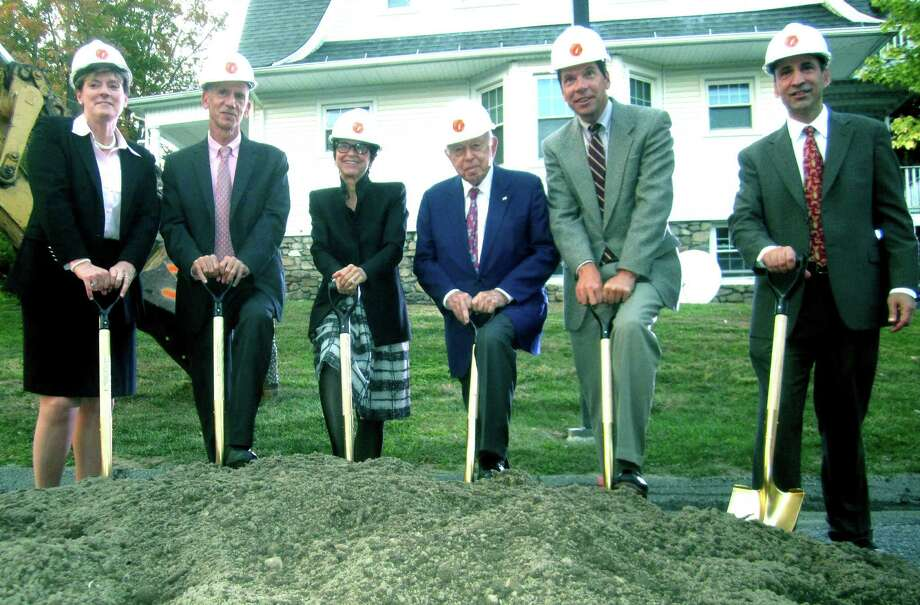 The ceremonial groundbreaking for New Milford Hospital's Arnhold Emergency Department kicks off with, from left to right, Deborah Weymouth, vice president of the Western Connecticut Health Network and CEO of New Milford Hospital;John and Jody Arnhold of Roxbury and John's father, Henry Arnhold; John Murphy, WCHN president and CEO; and Dr. Tom Koobatian, the medical director for the hospital's emergency staff. Oct. 4, 2013 Photo: Norm Cummings