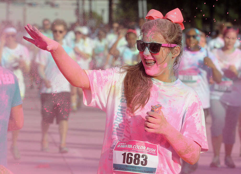 Participants in the Gift of Life 5K Ribbon Color Run trek through downtown Beaumont on Saturday. Runners finished the course covered in colored powder that was thrown on them during the run. Photo taken Guiseppe Barranco/The Enterprise Photo: Guiseppe Barranco, Photo Editor