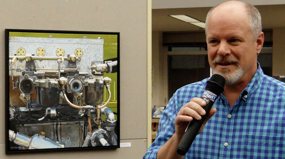"""Painter Ken Scaglia talks about his work at the opening of """"Art of the Automobile"""" showcasing his paintings Friday at the Westport Library. Photo: Mike Lauterborn / Westport News contributed"""