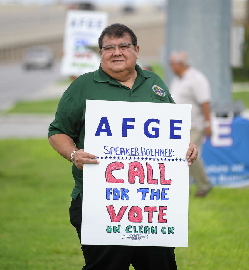 Roy Flores, American Federation of Government employees District 10 National Vice-President protests the government protest during a union sponsored event near their Vance Jackson and I10 headquarters Saturday. Photo: Robin Jerstad