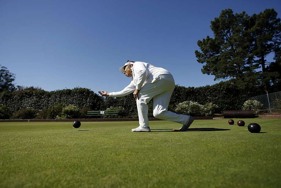 Christine Raher, a 2 year member, gets in a little practice bowling at the San Francisco Lawn Bowling Club in Golden Gate Park,  San Francisco, California Saturday October 5, 2013. Photo: Michael Short, The Chronicle