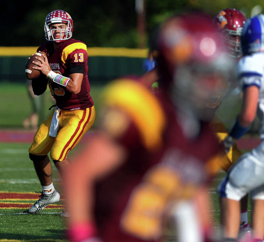 St. Joseph QB Jordan Vazzano lines up a pass, during high school football action against Darien in Trumbull, Conn. on Saturday October 5, 2013. Photo: Christian Abraham / Connecticut Post