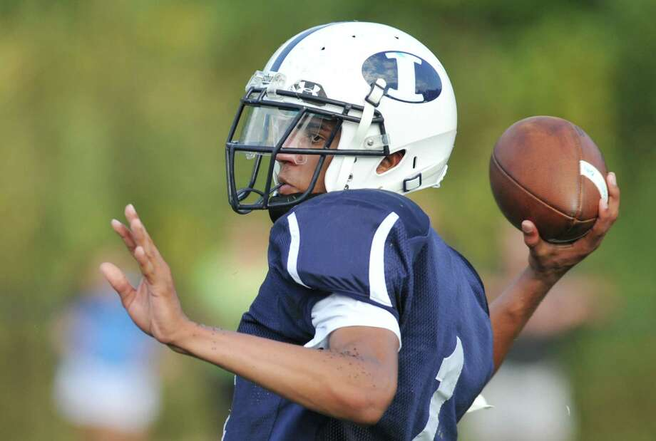 Immaculate quarterback Darel Bowman throws a pass in the SWC high school football game between Immaculate and Brookfield at Immaculate High School in Danbury, Conn. on Saturday, Oct. 5, 2013. Photo: Tyler Sizemore / The News-Times