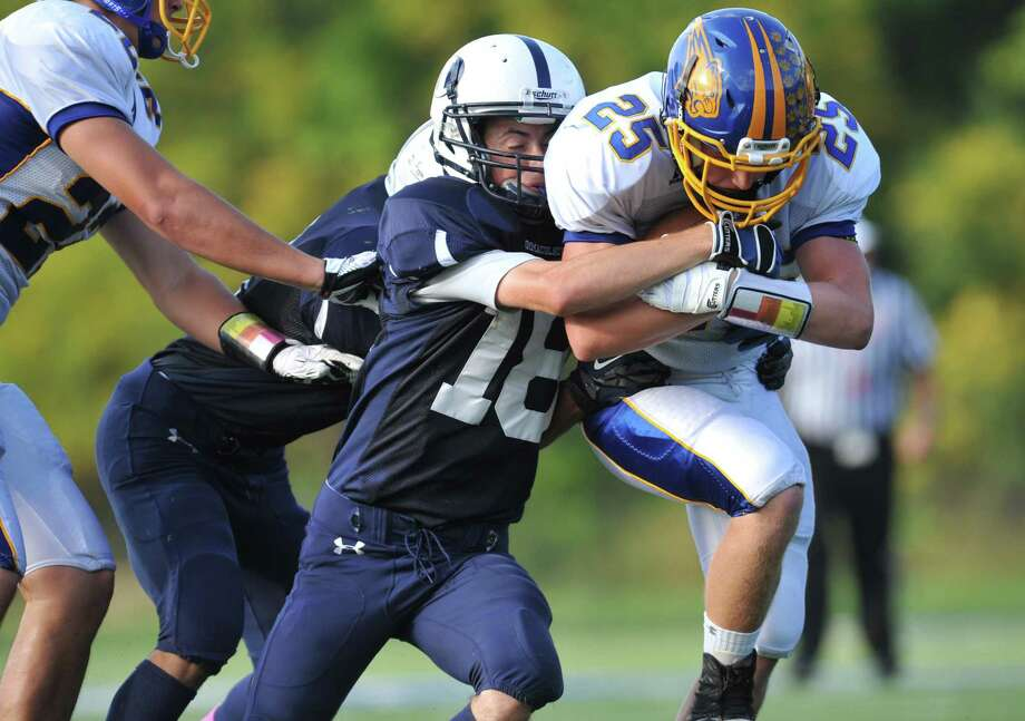 Immaculate's Shane Murphy (18) tackles Brookfield's Gabe Pompette (25) in the SWC high school football game between Immaculate and Brookfield at Immaculate High School in Danbury, Conn. on Saturday, Oct. 5, 2013. Photo: Tyler Sizemore / The News-Times