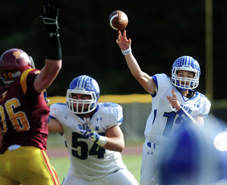 Darien QB Silas Wyper releases a pass, during high school football action against St. Joseph in Trumbull, Conn. on Saturday October 5, 2013. Photo: Christian Abraham / Connecticut Post