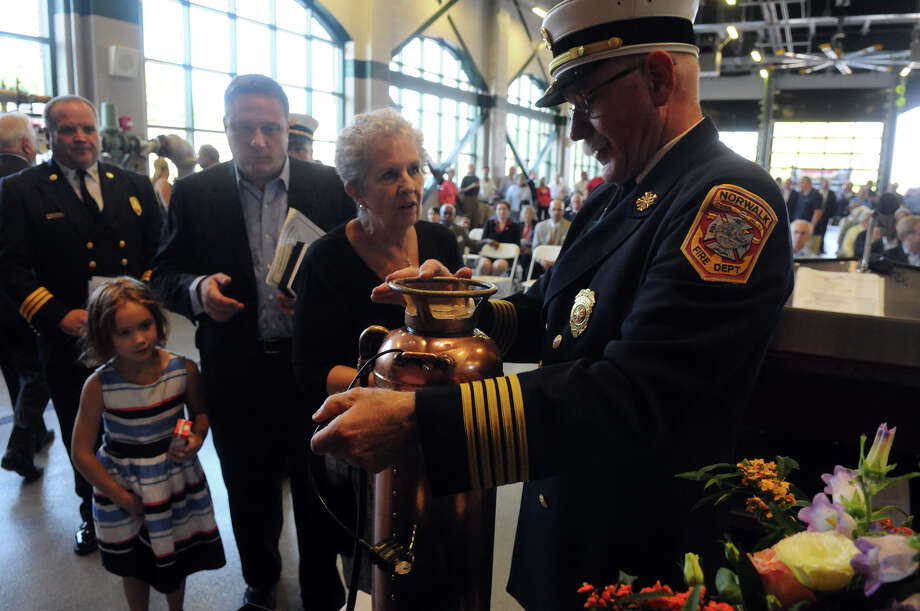 Chief Denis McCarthy opens a time capsule as Board of Fire Commissioners Carol Andreoli and Michael Coffey look on as Norwalk celebrates its new Central Fire Station and Emergency Operations Center with a dedication ceremony at 121 Connecticut Avenue in Norwalk, Conn., October 5, 2013. Photo: Keelin Daly / Stamford Advocate Freelance