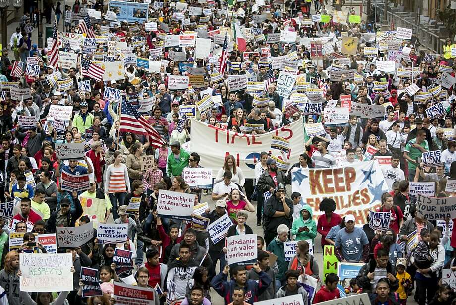 Thousands of supporters of an immigration overhaul demonstrate in Minneapolis, one of more than 150 rallies held nationwide. Photo: Jenn Ackerman, New York Times