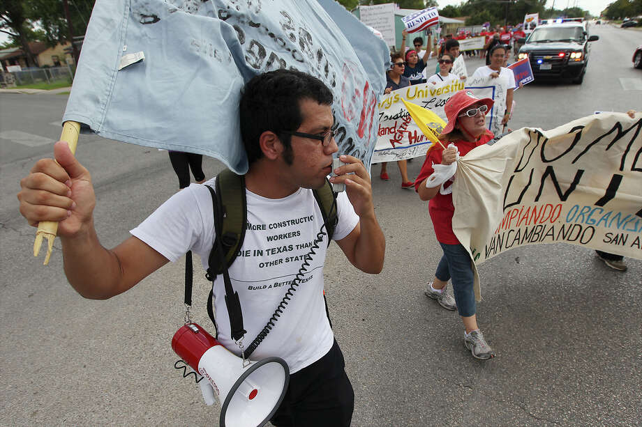 Hector Guzman Lopez of South Texas Civil Rights Project leads a portion of nearly 300 people in a march for immigration reform starting at Elmendorf Park on Saturday, Oct. 5, 2013. Local protestors joined other cities across the country in rallies to urge Congress to pass new laws allowing undocumented immigrants a pathway to citizenship. Photo: Kin Man Hui, San Antonio Express-News / ©2013 San Antonio Express-News