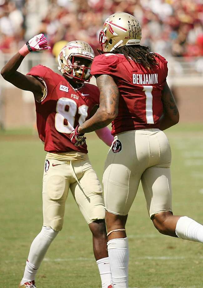 Florida State's Kenny Shaw and Kelvin Benjamin celebrate after one of the Seminoles' nine touchdowns in an ACC rout of Maryland. Photo: Stephen M. Dowell, McClatchy-Tribune News Service