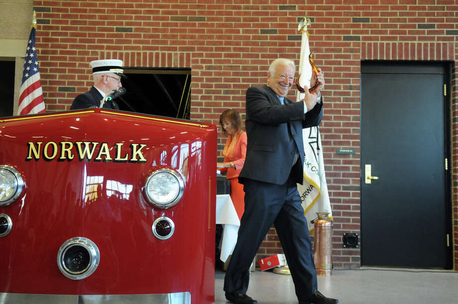 Norwalk Mayor Richard Moccia shows off an award of recognition he received during the celebration of the new Central Fire Station and Emergency Operations Center with a dedication ceremony at 121 Connecticut Avenue in Norwalk, Conn., October 5, 2013. Photo: Keelin Daly / Stamford Advocate Freelance