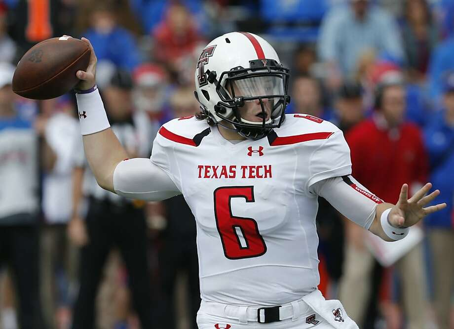 Texas Tech quarterback Baker Mayfield would need help off the field after a tackle at the end of the third quarter. Photo: Orlin Wagner, Associated Press