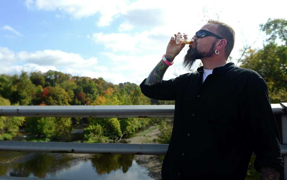 Steve Grayson, of Southington, samples a beer Saturday, Oct. 5, 2013 during the Smoke in the Valley chili and brew festival in Seymour, Conn. Photo: Autumn Driscoll / Connecticut Post