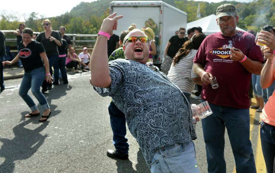 Craig Johnson, of Bethany, rocks out to live music Saturday, Oct. 5, 2013 during the Smoke in the Valley in Seymour, Conn. Photo: Autumn Driscoll / Connecticut Post