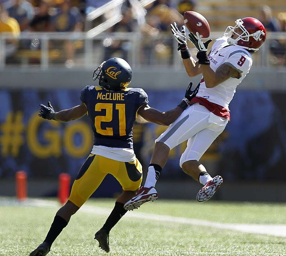 Washington State's Gabe Marks leaps to catch a first-half pass as Cal's Stefan McClure defends on the play. Photo: Tony Avelar, Associated Press
