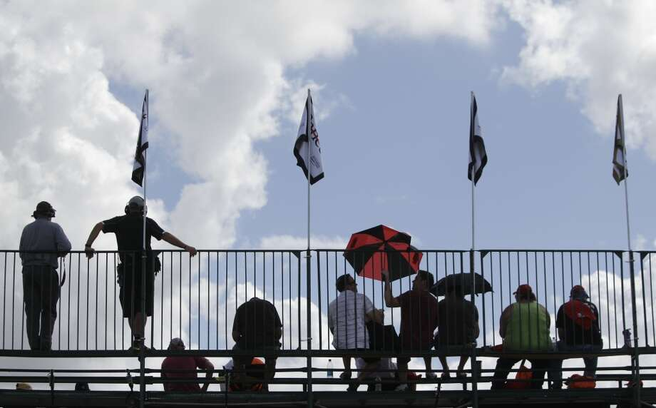 Fans brave the weather at the Grand Prix of Houston. Photo: Melissa Phillip, Houston Chronicle
