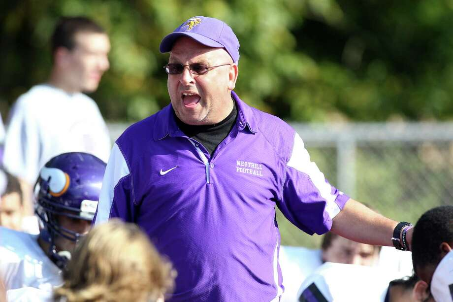 Westhill High School Head Caoch Frank Marcucio yells encouragement to his young Westhill team during halftime activity on Saturday against Brien McMahon. McMahon led by its strong special teams play won, 21-15. © J. Gregory Raymond for The Advocate Photo: J. Gregory Raymond / Stamford Advocate Freelance;  © J. Gregory Raymond