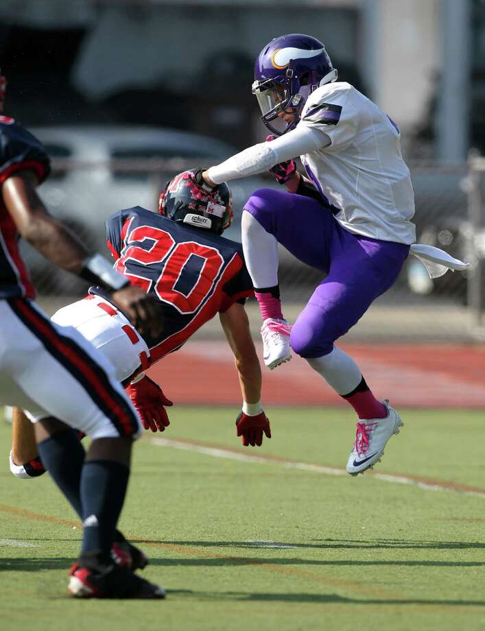 Westhill punter Blake Newcomer has his punt blocked for a McMahon score by Drew Pace during FCIAC football action on Saturday afternoon. Westhill, though down most of the game, made it close in losing 21-15. © J. Gregory Raymond for The Advocate Photo: J. Gregory Raymond / Stamford Advocate Freelance;  © J. Gregory Raymond