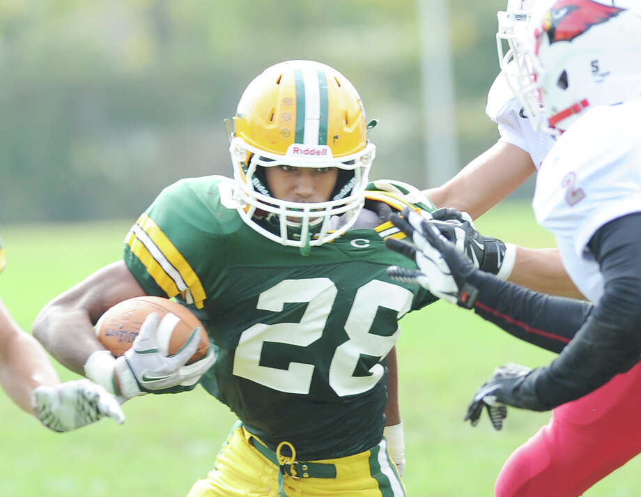 Randy Polonia (# 28) of Trinity Catholic in action during the high school football game between Greenwich High School and Trinity Catholic High School at Trinity in Stamford, Saturday, Oct. 5, 2013. Greenwich won the game over Trinity Catholic, 42-14. Photo: Bob Luckey / Greenwich Time
