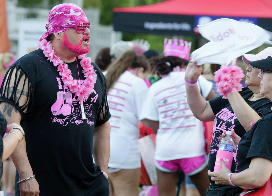Many participants came fully dressed in support of the Susan G. Komen Race For the Cure on Saturday, October 5th, 2013 along Allen Parkway in Houston, TX. Photo: Jamaal Ellis, For The Chronicle / ©2013 Houston Chronicle