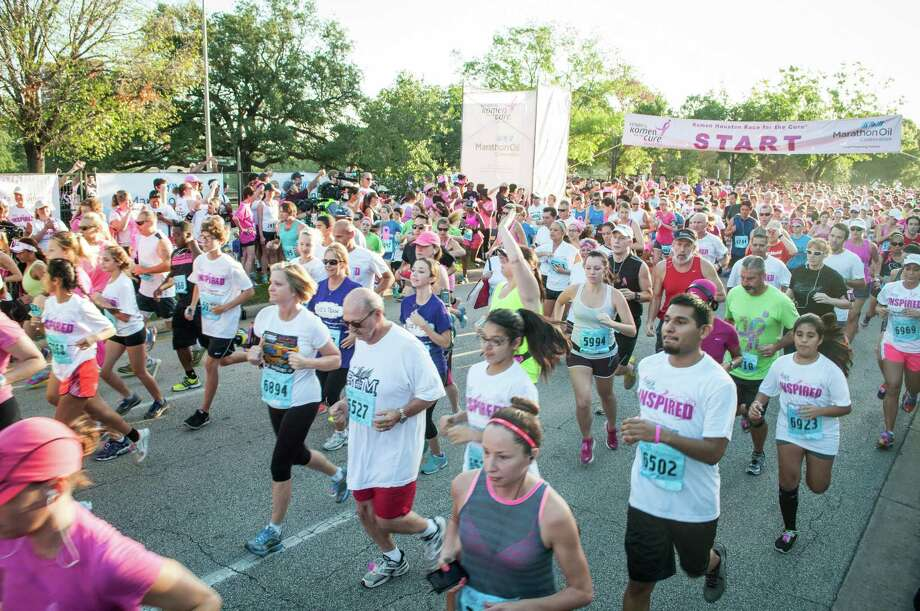 Runners at the start of the Susan G. Komen Race For the Cure on Saturday, October 5th, 2013 along Allen Parkway in Houston, TX. Photo: Jamaal Ellis, For The Chronicle / ©2013 Houston Chronicle