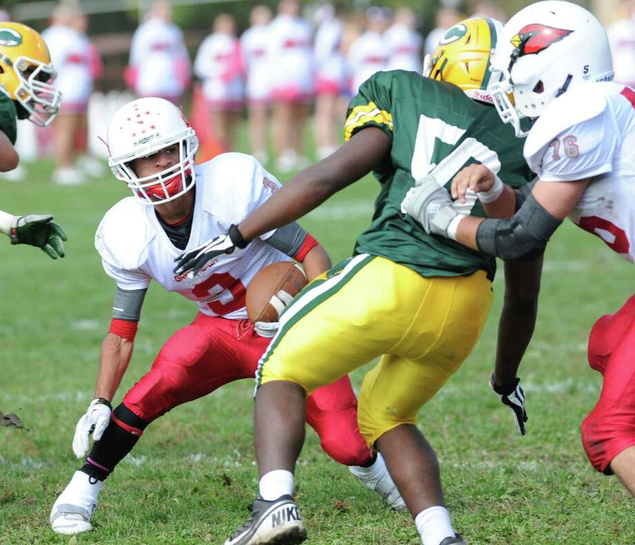 High school football game between Greenwich High School and Trinity Catholic High School at Trinity in Stamford, Saturday, Oct. 5, 2013. Greenwich won the game over Trinity Catholic, 42-14. Photo: Bob Luckey / Greenwich Time
