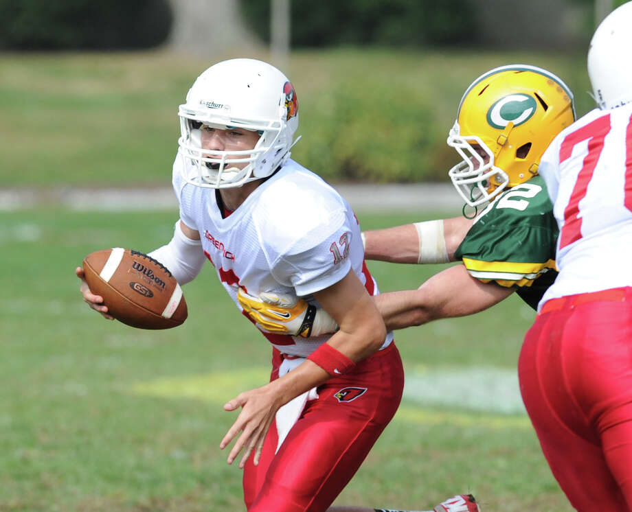 Greenwich quarterback Matt Marzulla, left, during the high school football game between Greenwich High School and Trinity Catholic High School at Trinity in Stamford, Saturday, Oct. 5, 2013. Greenwich won the game over Trinity Catholic, 42-14. Photo: Bob Luckey / Greenwich Time