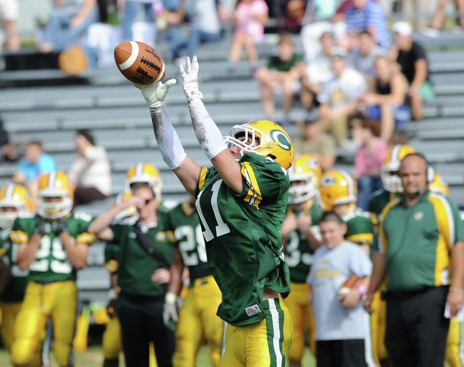 Matt Christensen (# 11) of Trinity Catholic catches a pass during the high school football game between Greenwich High School and Trinity Catholic High School at Trinity in Stamford, Saturday, Oct. 5, 2013. Greenwich won the game over Trinity Catholic, 42-14. Photo: Bob Luckey / Greenwich Time