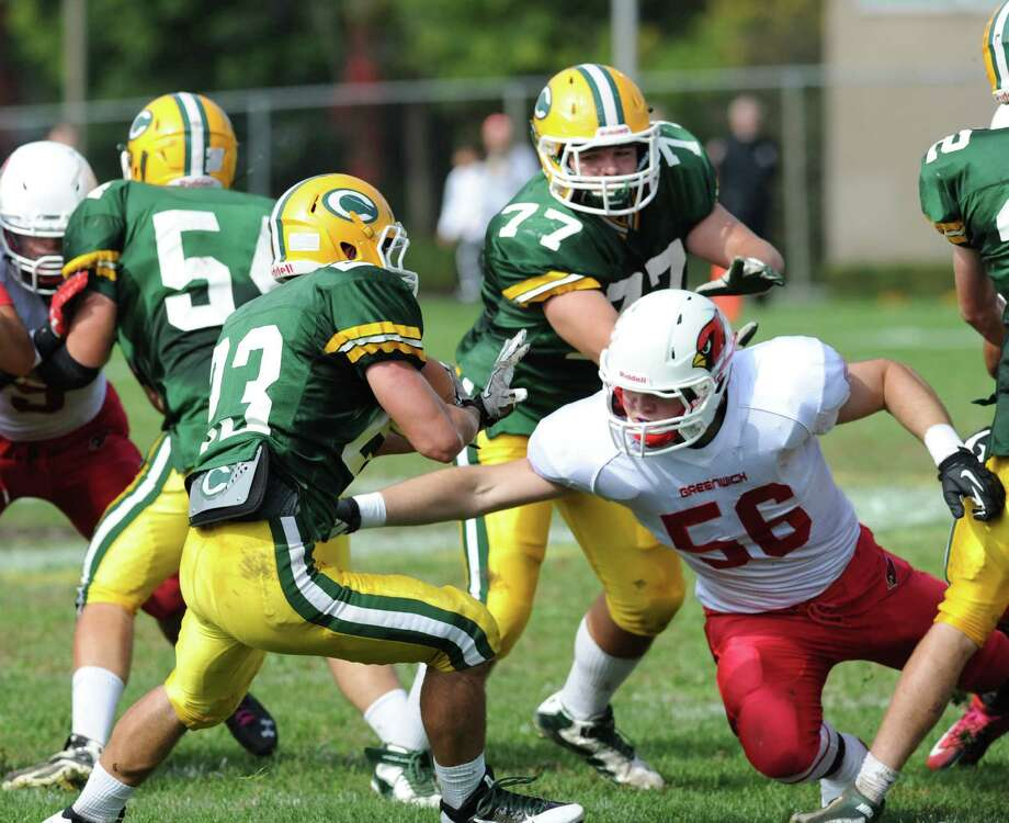 Jack Wynne (# 56) of Greenwich goes for the tackle during the high school football game between Greenwich High School and Trinity Catholic High School at Trinity in Stamford, Saturday, Oct. 5, 2013. Greenwich won the game over Trinity Catholic, 42-14. Photo: Bob Luckey / Greenwich Time