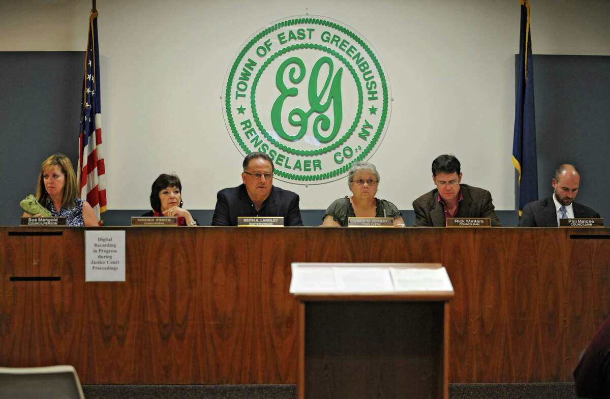 The town board holds a hearing to discuss a new draft of the East Greenbush ethics code this September. The law has not been updated since 1974. From left are, Councilwoman Sue Mangold, Councilwoman Virginia O'Brien, Supervisor Keith Langley, Town Clerk Linda Kennedy, Councilman Rick Matters and Councilman Philip Malone. (Lori Van Buren / Times Union)