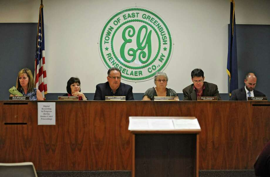 The town board holds a hearing to discuss a new draft of the East Greenbush ethics code this September. The law has not been updated since 1974. From left are, Councilwoman Sue Mangold, Councilwoman Virginia O'Brien, Supervisor Keith Langley, Town Clerk Linda Kennedy, Councilman Rick Matters and Councilman Philip Malone. (Lori Van Buren / Times Union) Photo: Lori Van Buren / 00023894A