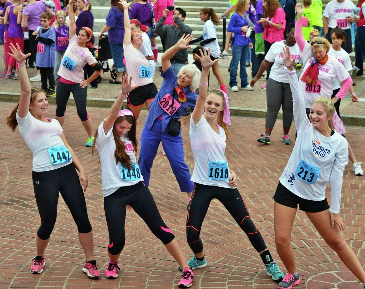 Shen students, from left, Julia Smith, 15, Jamie Burton, 15, Courtney guiry, 16, and Taylor Schaap, 15, join in a Zumba session on the Empire State Plazaafter running in the 19th Annual Susan G. Komen Northeastern New York Race for the Cure 5K Saturday Oct. 5, 2013, in Albany, NY. (John Carl D'Annibale / Times Union)