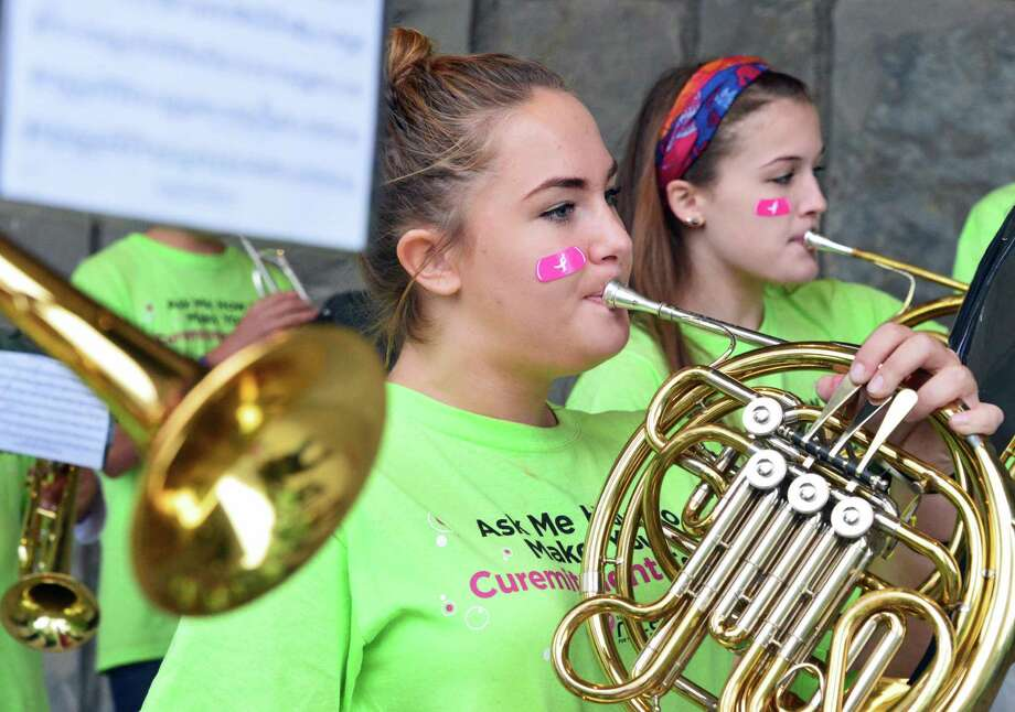 French horn players Allison Sargent, 16, let, and Emily Barno, 14, march with the Ballston Spa Marching band during the 2Mile Family Walk at the 19th Annual Susan G. Komen Northeastern New York Race for the Cure at the Empire State Plaza Saturday Oct. 5, 2013, in Albany, NY.   (John Carl D'Annibale / Times Union) Photo: John Carl D'Annibale / 00024077A