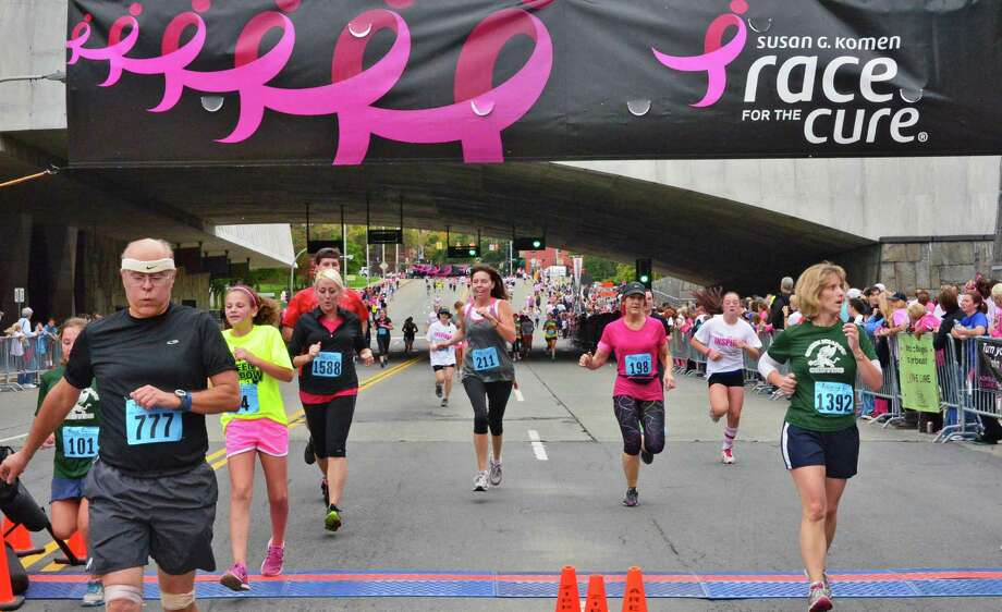 Komen's 2014 Race for the Cure Fairfield County run to benefit breast cancer research is this Satuday in Norwalk. Find out more.  Photo: John Carl D'Annibale / 00024077A