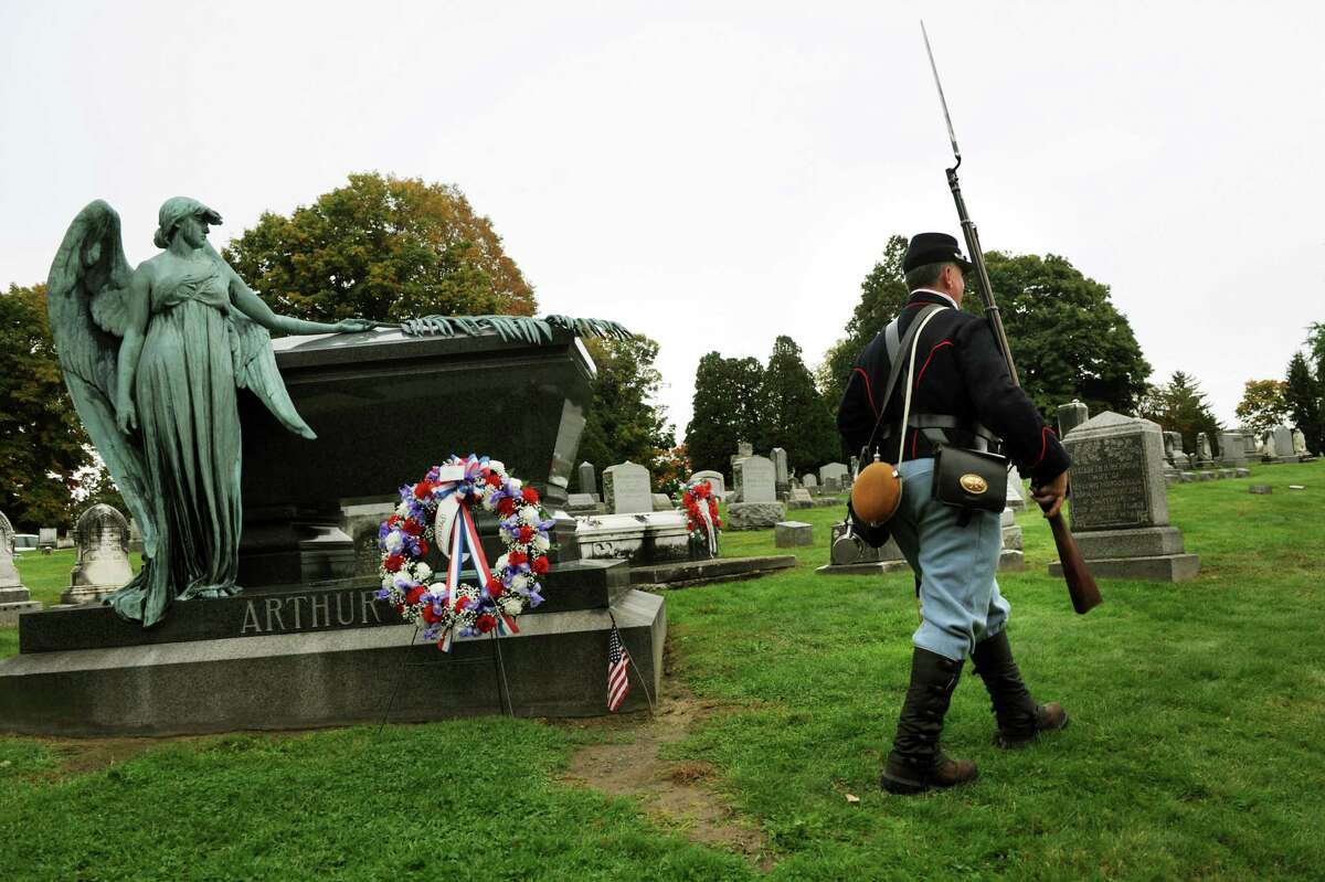 Reenactor Jim Verhagen of Watervliet, portraying a Union infantryman from the Civil War, walks by President Chester Alan Arthur's grave on Saturday, Oct. 5, 2013, at Albany Rural Cemetery in Menands, N.Y. Verhagen offered his services when he learned of the scaled-back service to honor the president's birthday. (Cindy Schultz / Times Union)