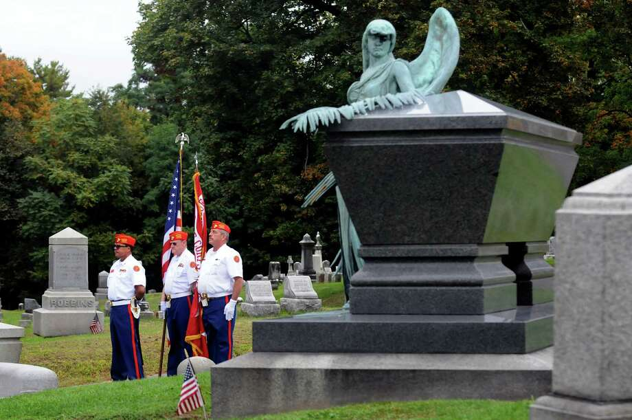 Members of the Captain William Dale O'Brien Detachment of the Marine Corps League performs color guard duty during a scaled-down ceremony to President Chester Alan Arthur on his birthday on Saturday, Oct. 5, 2013, at Albany Rural Cemetery in Menands, N.Y. From left are Capt. Williams Keyes, Pete Grobecker and Mick DellaValle. (Cindy Schultz / Times Union) Photo: Cindy Schultz / 00024128A